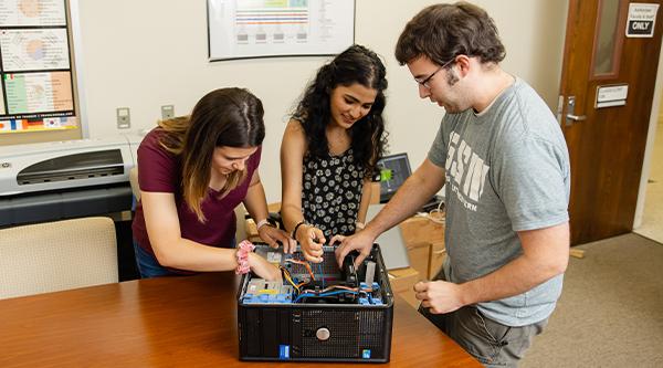 Students building computer