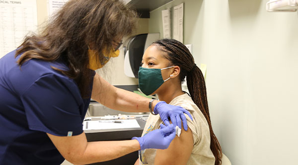 Student Receiving Vaccine
