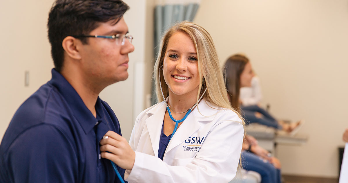 nursing student performs check-up on patient