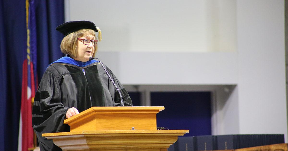 Dr. Liz Wilson speaking at graduation